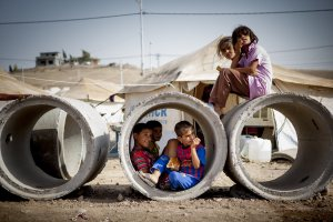 Sept. 3, 2013 - A group of refugee kids sitting on some drain pipes and using them as a playground at Quru Gusik Refugee Camp.....Photo: Flo Smith/NurPhoto (Credit Image: © Flo Smith/NurPhoto/ZUMAPRESS.com)